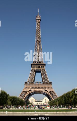 The Eiffel Tower viewed from Parc du Champs de Mars, Paris - Stock Photo
