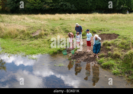 Family fishing with nets in side pond / stream Coe Fen Cambridge - Stock Photo