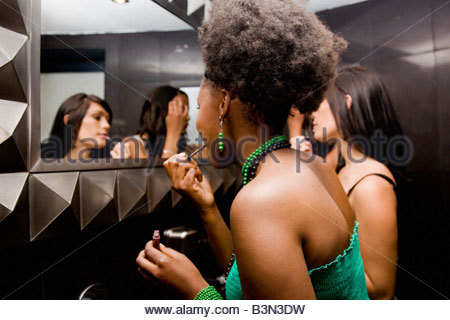 SSCD002-072 © Storm Photographic Studio  aFRIKA Collection  Great Stock ! Girls doing make-up in bathroom mirror - Stock Photo