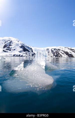 Melting, drifting ice block, Beloit Glacier, Blackstone Bay, Pacific Coast, Prince William Sound, Chugach National - Stock Photo