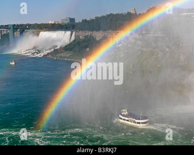 Canada,Ontario,Niagara Falls,Maid of the Mist tour boat approaching the American Falls with a rainbow - Stock Photo