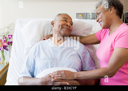Senior Couple In Hospital Room - Stock Photo
