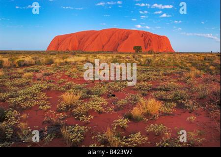 Ayers Rock at sunset Kata Tjuta National Park Northern Territory Australia - Stock Photo