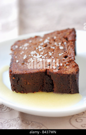 chocolate cake with melted salted butter - Stock Photo
