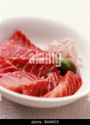 Pieces of raw marinated red tuna - Stock Photo
