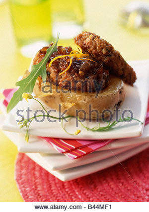 Sausages with confit onions - Stock Photo