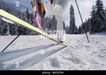 Austria, Salzburger Land, Altenmarkt-Zauchensee, Person cross country skiing, low section - Stock Photo