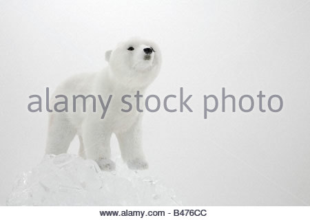 A toy polar bear and ice - Stock Photo