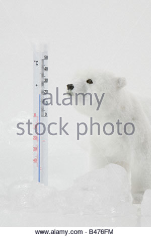 A toy polar bear ice and a thermometer - Stock Photo