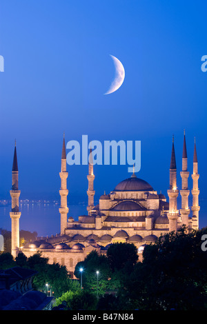 Crescent moon over Sultan Ahmed Mosque Blue Mosque Turkey Istanbul - Stock Photo