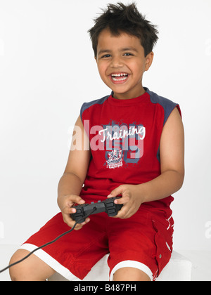 asain boy playing on his play station - Stock Photo