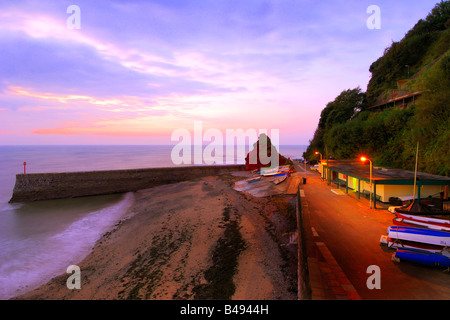 Sunrise from the beach at Dawlish in South Devon - Stock Photo