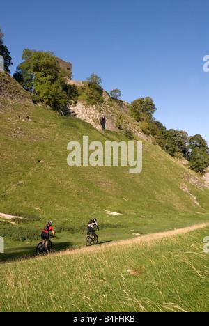 Mountain biking through Cavedale Castleton Peak District National Park Derbyshire England UK GB - Stock Photo