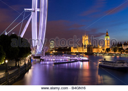 River Thames, 'The Eye' and Houses of Parliament at dusk, London, England, UK - Stock Photo