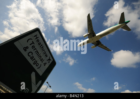 Airbus A320 214 Airplane coming in to land at heathrow Airport London Britain Uk england - Stock Photo