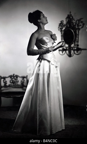 Jean Kent in Evening Dress Jean Kent star of Bond Street models her most glamourous evening gown created for her - Stock Photo