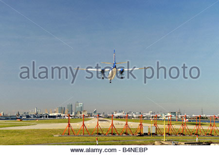 An aircraft landing at the London City Airport - Stock Photo