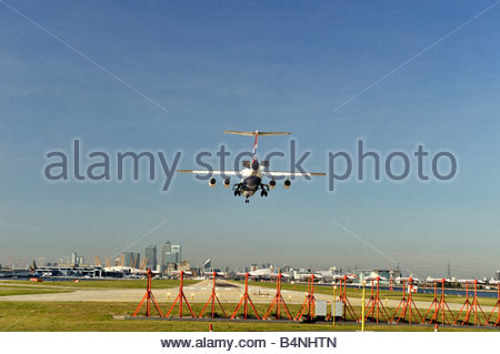 A regional jet airliner landing at London City Airport - Stock Photo