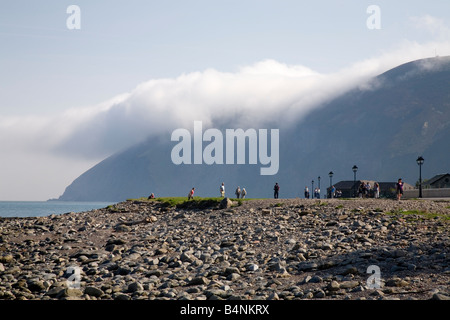Lynmouth eastern beach with Foreland Point Devon shroaded by low cloud - Stock Photo