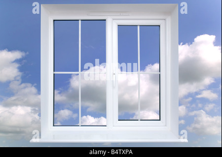 White window frame against a blue cloudy sky - Stockfoto