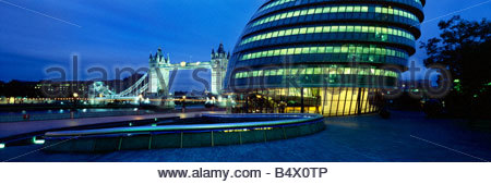 City Hall and Tower Bridge at dusk, London, England, UK - Stock Photo