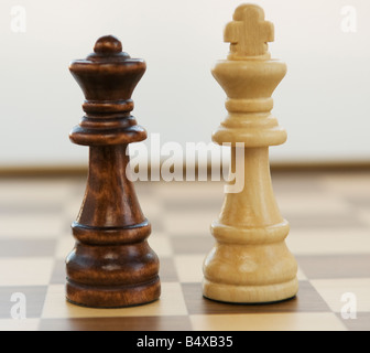 Opposing king and queen chess pieces - Stock Photo