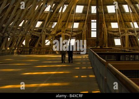 Two men walking along the mezzanine floor of No 3 Slip Cover Chatham Historic Dockyard in Kent. - Stock Photo