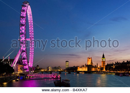 River Thames, 'The Eye' and Houses of Parliament at sunset, London, England, UK - Stock Photo
