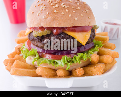Cheese Burger In A Sesame Seed Bun With Fries - Stock Photo