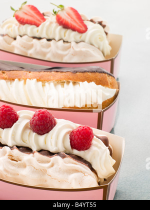 Creamed Meringue And Chocolate Eclair - Stock Photo