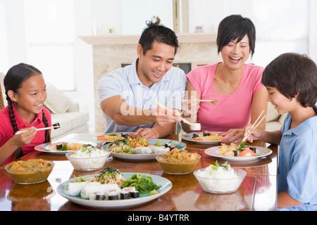 Family Enjoying Meal Together - Stockfoto