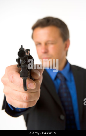 Businessman Pointing Hand Gun - Stock Photo