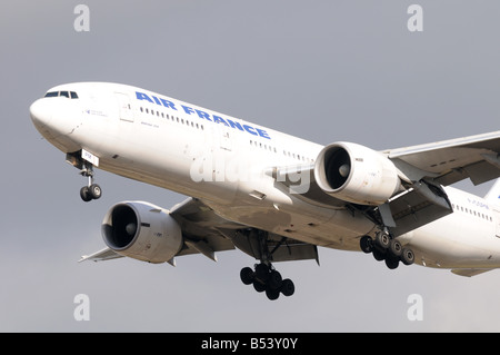 Airplane coming in to land at heathrow Airport London Britain Uk england - Stock Photo