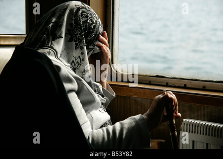 Old muslim woman on a ferry, Istanbul, Turkey - Stock Photo