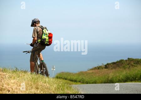Mountain Biker Checking Map - Stock Photo