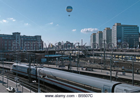 View across the central station in the center of Hamburg, Germany with a hot-air balloon in the sky. - Stock Photo