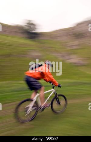 mountain biking Cavedale Castleton in the Peak District National Park Derbyshire UK England GB Great Britain - Stock Photo
