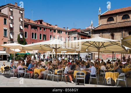 Lunch at a restaurant in Campo Santo Stefano in the district of San Marco, Venice, Veneto, Italy - Stock Photo