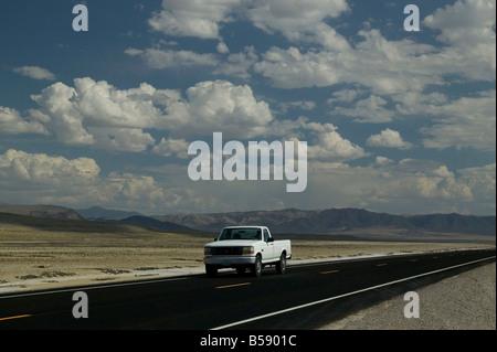 Pick up truck on highway 50 Nevada desert USA - Stock Photo
