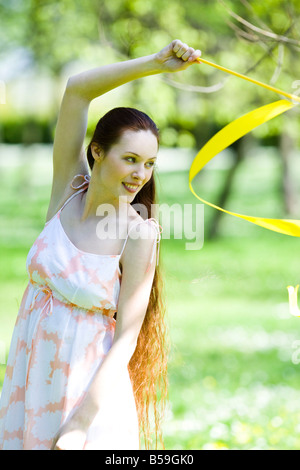 young woman with sash in park - Stock Photo
