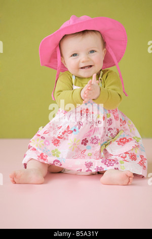 Happy baby girl in summer dress - Stock Photo