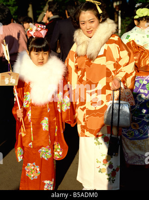 Girl and woman in traditional dress, Japan - Stock Photo