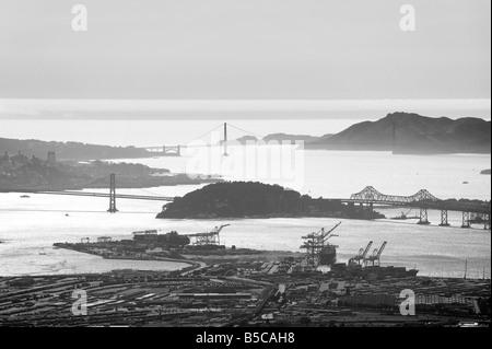 aerial view above the Port of Oakland to the Bay Bridge Treasure Island and Golden Gate bridge San Francisco bay - Stock Photo