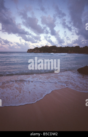 Waves on a beach near Port Antonio Jamaica - Stock Photo