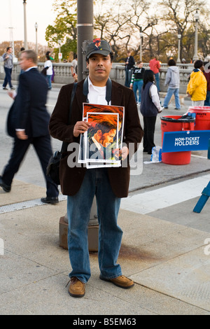 A man holding a portrait of Barack Obama before his presidential rally at Grant Park in Chicago Illinois on November - Stock Photo