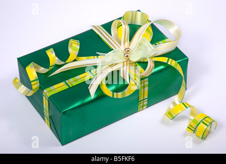 green gift box with ribbon and bow - Stock Photo