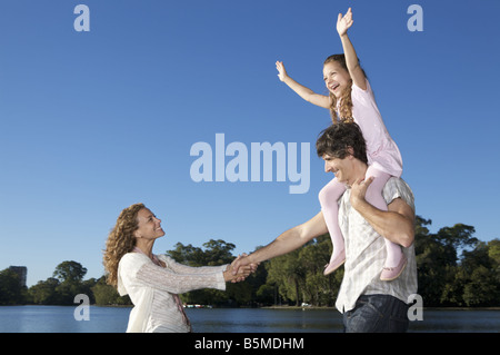 A couple walking with a child - Stock Photo