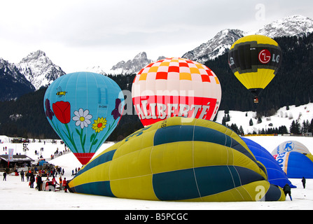 Hot air balloons on the launching site, International Balloon Festival, Chateau d Oex, Switzerland - Stock Photo