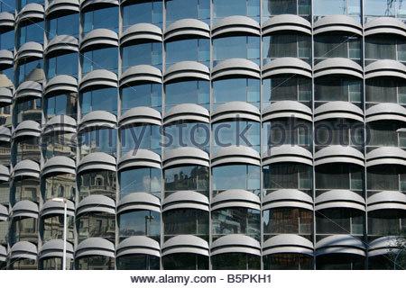Windows on the facade of a multistorey building - Stock Photo