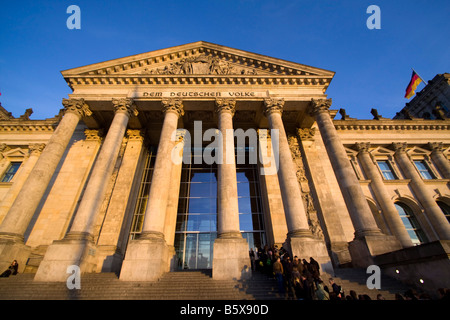 Reichstag building columns at the entrance people queeing outdoors Berlin - Stock Photo